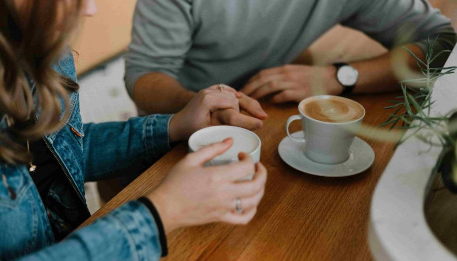 people chatting with coffee